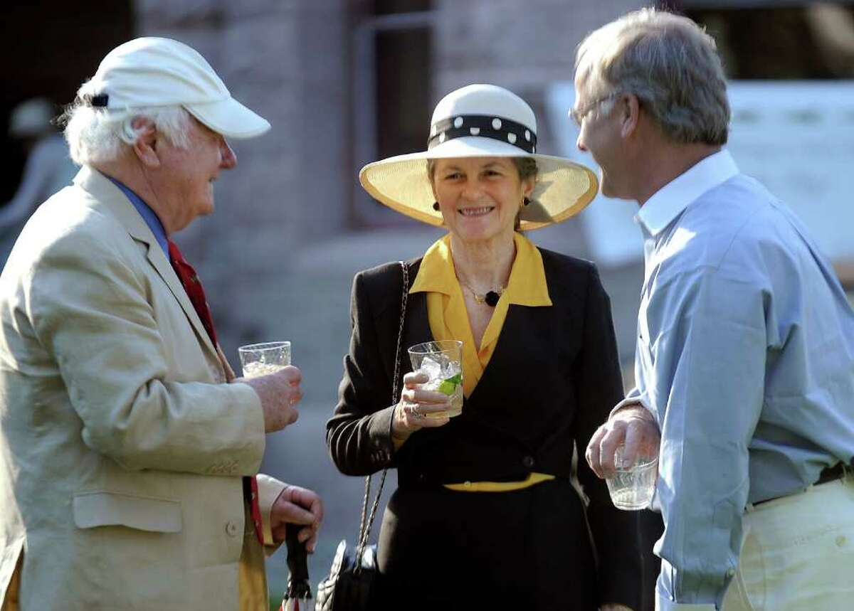 Participants enjoy the Pequot Library's Derby Day party on Saturday, May 7, 2011.