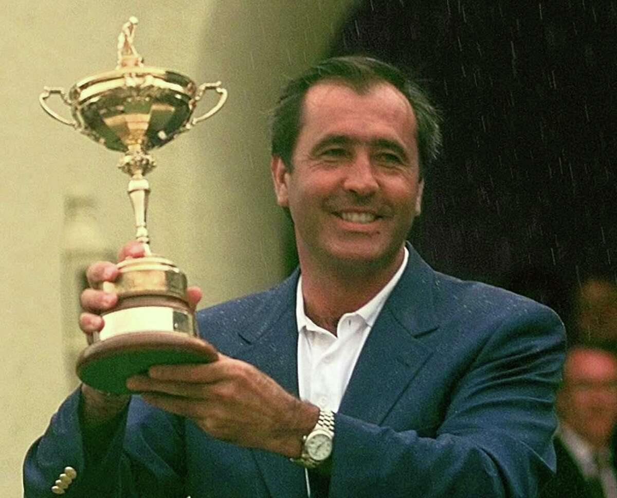 FILE - In this Sept. 28, 1997 file photo, European Ryder Cup team captain Seve Ballesteros holds the trophy in the rain after Europe beat the United States to win the Ryder Cup at Valderrama golf course in southern Spain. Ballesteros died, early Saturday May 7, 2011 according to a statement on his website. The 54-year-old Spanish golf great had been resting at his home in Pedrena, northern Spain, where he has mostly been since undergoing four operations to remove a brain tumor in late 2008. (AP Photo/Dave Martin, File)