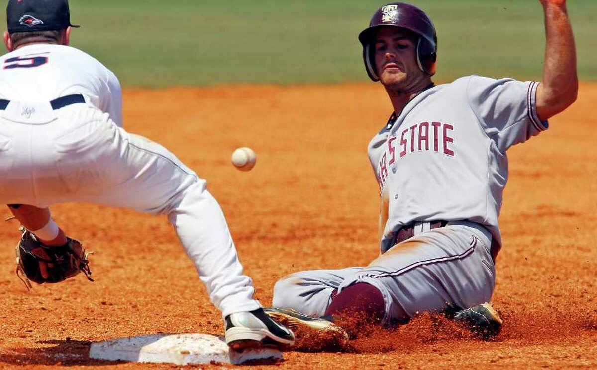 FOR SPORTS - Texas State's Jeff McVaney slides safely into third base under UTSA's Ryan Dalton during the second inning Saturday May 7, 2011 at Roadrunner Field. Texas State won 9-7. (PHOTO BY EDWARD A. ORNELAS/eaornelas@express-news.net)