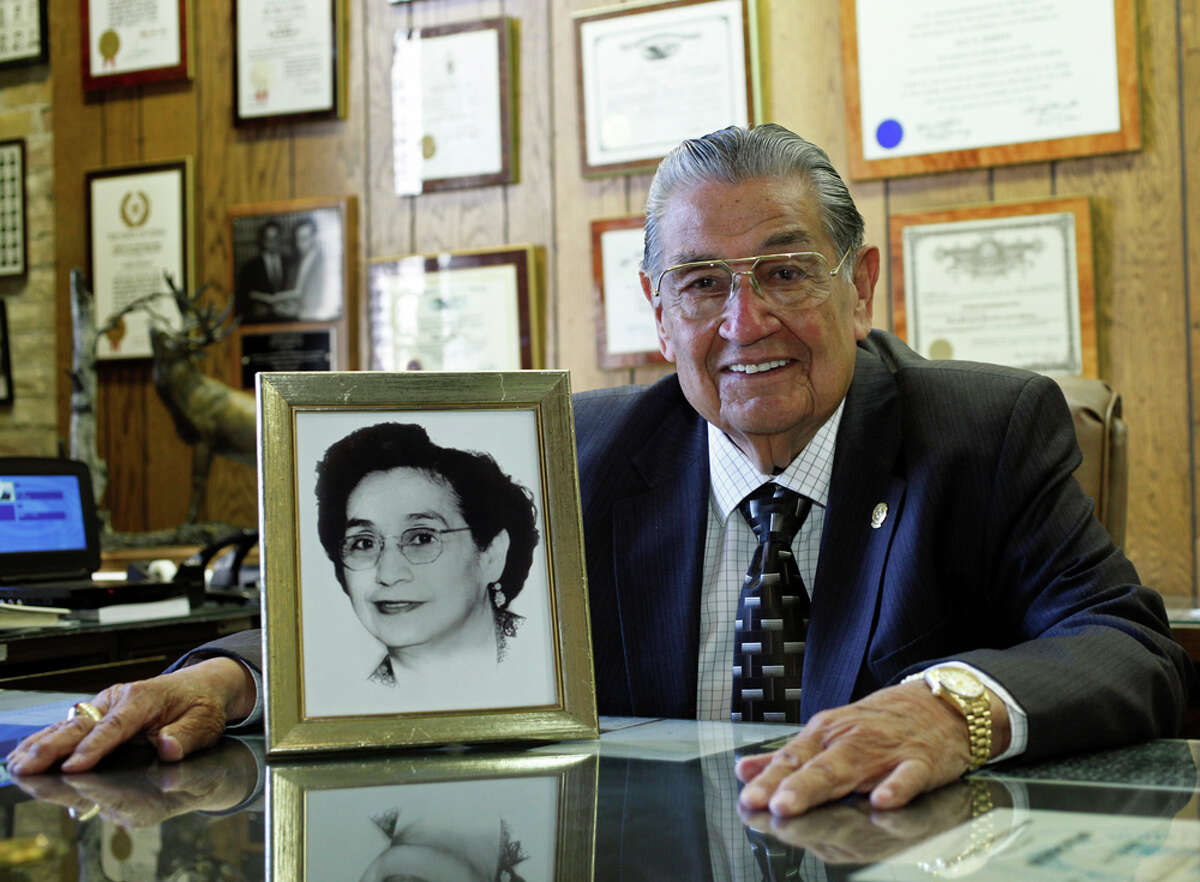 Attorney and former Texas Secretary of State Roy Barrera Sr. is photographed in his office with a portrait of his mother, Rosaura Cantu Barrera, whom he credits with pushing him to finish his education. J. MICHAEL SHORT / SPECIAL TO THE EXPRESS-NEWS