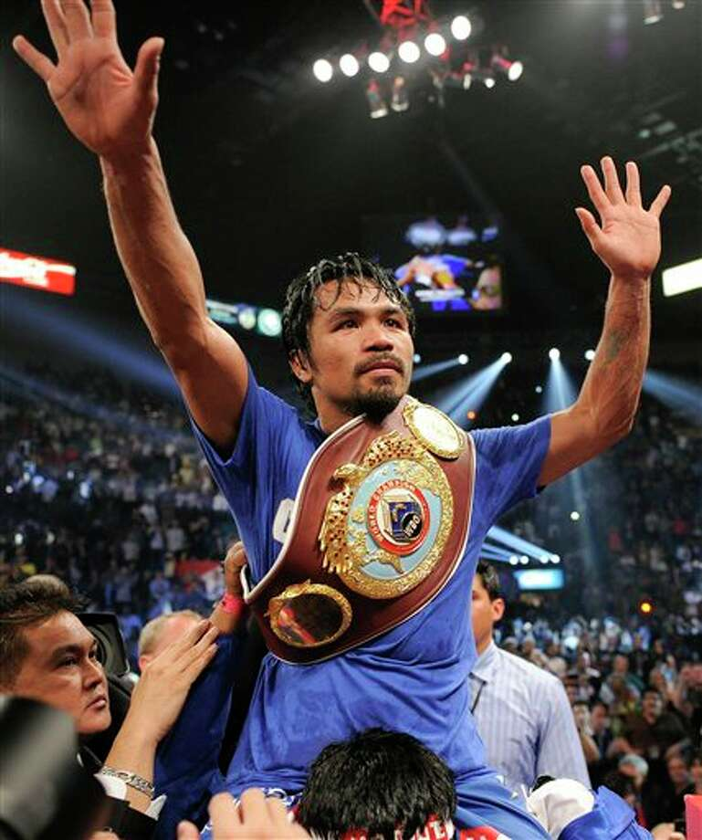 Manny Pacquiao celebrates after defeating Shane Mosley by unanimous decision during a WBO welterweight title bout, Saturday, May 7, 2011, in Las Vegas.  (AP Photo/Mark Terrill) Photo: Associated Press