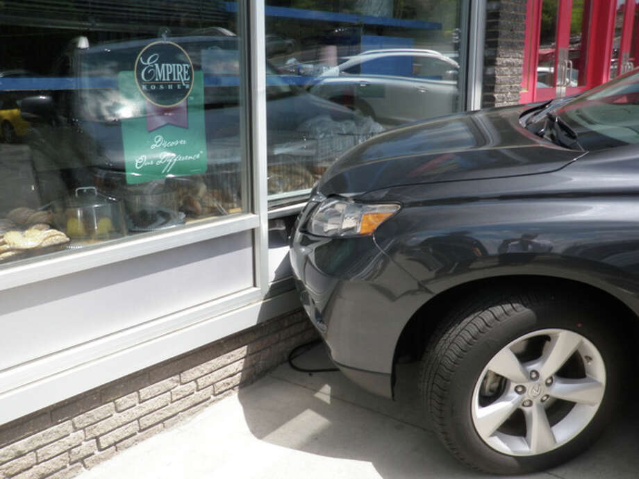 This Lexus RX struck the front of Gold's Delicatessen on the Post Road in Westport on Saturday afternoon. No serious damage or injuries were reported. Photo: Contributed Photo/Westport Fire Department / Westport News contributed