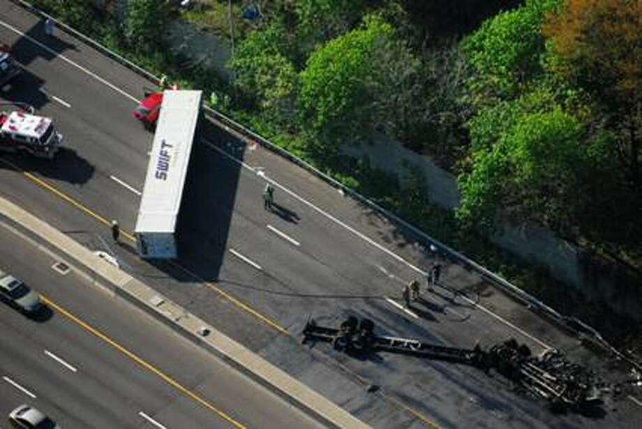 State police are investigating the cause of a tractor-trailer accident that shut down Interstate 95 northbound for more than six hours Saturday morning. Photo: Morgan Kaolian/Aeropix / Connecticut Post