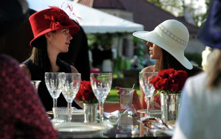 Marlowe Mitchell, left, and Caitlin Kneisel, right, talk during the Pequot Library's Derby Day party on Saturday, May 7, 2011. Photo: Lindsay Niegelberg / Connecticut Post