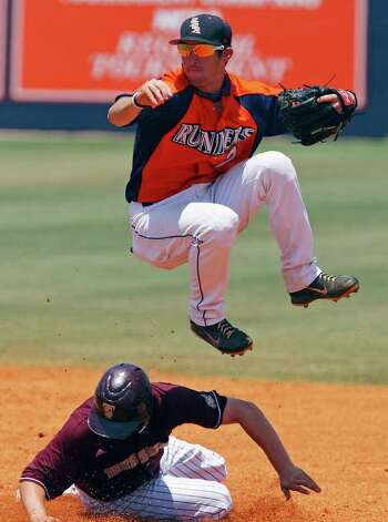 FOR SPORTS - UTSA's RJ Perucki leaps over Texas State's Cory Falvey while trying to turn the double play in the second inning Sunday May 8, 2011 at  Roadrunner Field. Texas State won 7-6. (PHOTO BY EDWARD A. ORNELAS/eaornelas@express-news.net) Photo: EDWARD A. ORNELAS, Edward A. Ornelas/Express-News / SAN ANTONIO EXPRESS-NEWS (NFS)