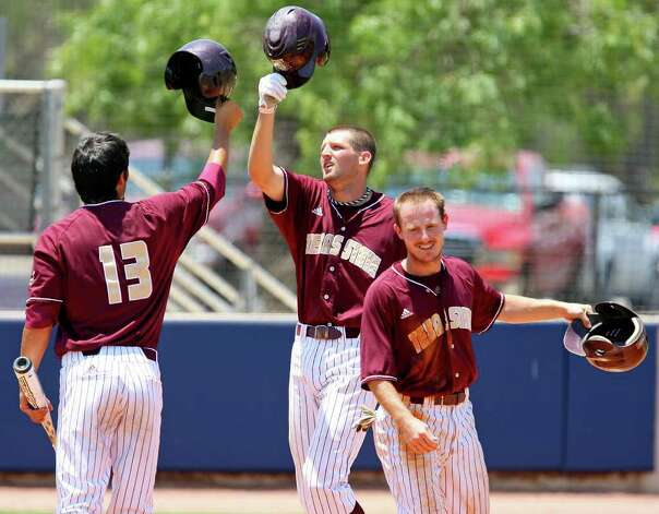 FOR SPORTS - Texas State's Kyle Kubitza (center) celebrates with teammates Christian Gallegos (left) and Bret Atwood (right) after hitting a grad slam home run agaisnt UTSA during the second inning Sunday May 8, 2011 at Roadrunner Field. Texas State won 7-6. (PHOTO BY EDWARD A. ORNELAS/eaornelas@express-news.net) Photo: EDWARD A. ORNELAS, Edward A. Ornelas/Express-News / SAN ANTONIO EXPRESS-NEWS (NFS)