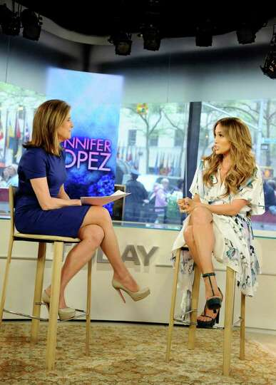 In this publicity image released by NBC, co-host Meredith Vieira, left, talks with actress, singer a