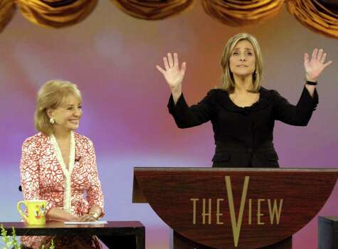"This photo, supplied by ABC, shows Meredith Vieira saying her goodbyes on ABC's ""The View"" television talk show as her co-host Barbara Walters, left, smiles on during  Vieira's farewell show  in New York Friday, June 9,2006. Vieira is leaving to join ""Today"" on NBC is September. Photo: STEVE FENN, AP / ABC"