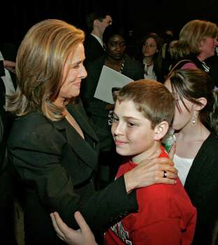 "**FILE**Meredith Vieira, the new co-host of the NBC ""Today"" television show is greeted by her son Gabriel Cohen, center, and daughter Lily Cohen, partially hidden, at a New York news conference, announcing her new job on April 6, 2006. After nine years as the traffic cop at ""The View,"" she's leaving Friday, June 9, 2006, and willl be replaced by Rosie O'Donnell in September. That same month, Vieira takes the chair beside Matt Lauer on ""Today."" Photo: RICHARD DREW, AP / AP"