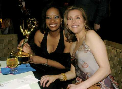 "NEW YORK - MAY 16:  Meredith Vieira of ""The View"" and Producer Audrey Jones celebrate their win for Best Daytime Talk Show (a tie with ""The Wayne Brady Show"") at the ABC after party for the 30th Annual Daytime Emmy Awards May 16, 2003 at the Sea Grill Restaurant in New York City.  (Photo by Getty Images). Photo: Myrna Suarez, Getty Images / 2003 Getty Images"