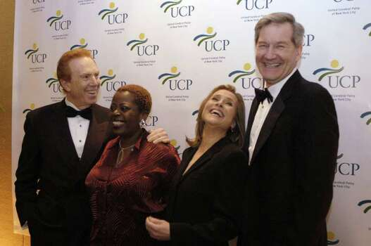 NEW YORK - APRIL 23:  Alan Kalter (L to R), Lillias White, Meredith Vieira, and Vice President of Johnson and Johnson Russell C. Deyo attend the 48th Annual United Cerebral Palsy of New York City Awards Dinner April 23, 2003 in New York.  Vieria served as Master of Ceremonies for the event held at the Mariott Marquis Ballroom in New York City. Photo: Myrna Suarez, Getty Images / 2003 Getty Images