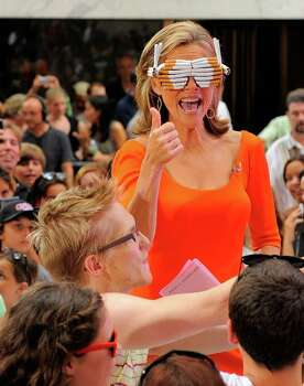 "NEW YORK - JULY 09:  Media personality Meredith Vieira models a pair of cigarette glasses created by a Lady Gaga fan during a taping of NBC's ""Today"" in Rockefeller Center on July 9, 2010 in New York City.  (Photo by Jemal Countess/Getty Images) *** Local Caption *** Meredith Vieira Photo: Jemal Countess, Getty Images / 2010 Getty Images"