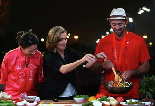BEIJING - AUGUST 21:  (L-R) News anchor Ann Curry, show host Meredith Vieira and US Rowing team member Bryan Volpenhein cook in the NBC Today Show Studio at the Beijing 2008 Olympic Games on August 21, 2008 in Beijing, China. Photo: Ryan Pierse, Getty Images / 2008 Getty Images