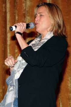 "NEW YORK - APRIL 05:  Meredith Vieira performs Billy Ray Cyrus' ""Achy Breaky Heart"" during karaoke at the Fifth Annual National Love Our Children Day at Spotlight Live on April 5, 2008 in New York City. Photo: Rob Loud, Getty Images / 2008 Getty Images"