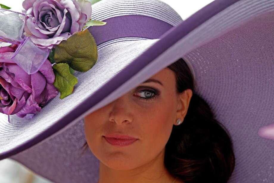 Tamara Sorreoo, from Austin, Tx., shows off her Derby hat before the 137th Kentucky Derby horse race at Churchill Downs Saturday, May 7, 2011, in Louisville, Ky. (AP Photo/Denis Paquin) Photo: Denis Paquin, STF