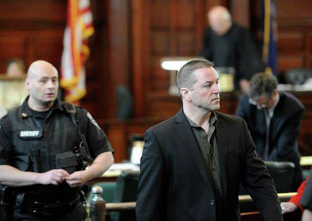 Michael Mosley, right,  leaves Rensselaer County Court in Troy on May 9, 2011.    (Skip Dickstein / Times Union) Photo: SKIP DICKSTEIN / 00013077A