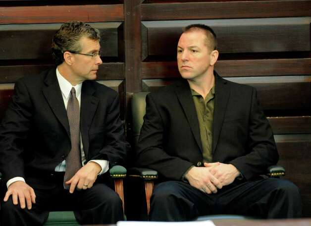 Michael Mosley, right, sits in the courtroom in the Rensselaer County Courthouse in Troy, N.Y. during a brief recess in his murder trial May 9, 2011.    (Skip Dickstein / Times Union) Photo: SKIP DICKSTEIN / 00013077A