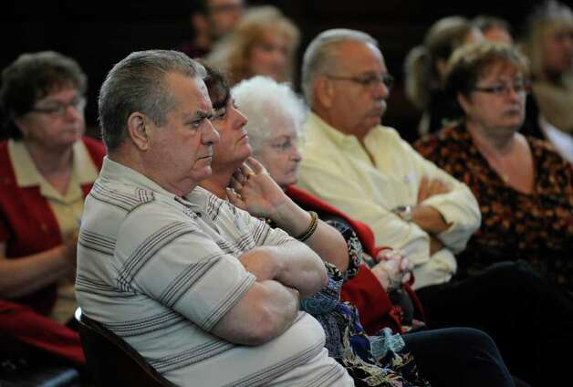 Members of MIchael Mosley listen to opening statements in the Rensselaer County Courthouse in Troy, N.Y. during Mosley's murder trial May 9, 2011.    (Skip Dickstein / Times Union) Photo: SKIP DICKSTEIN / 00013077A
