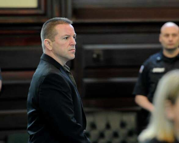 Michael Mosley stands at the beginning of a brief recess in his murder trial May 9, 2011, in Rensselaer County Court. (Skip Dickstein / Times Union) Photo: SKIP DICKSTEIN / 00013077A