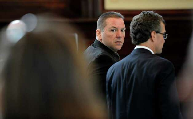 Michael Mosley, center,  looks toward the gallery of the courtroom Monday in  Rensselaer County Court.  (Skip Dickstein / Times Union) Photo: SKIP DICKSTEIN / 00013077A