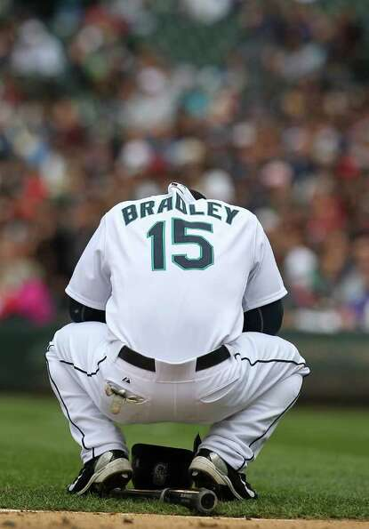 SEATTLE - MAY 23:  Milton Bradley #15 of the Seattle Mariners squats  near home plate after striking