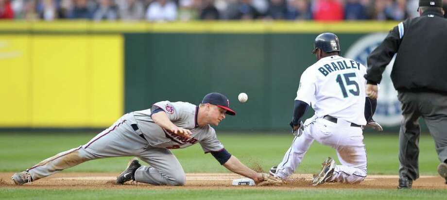 SEATTLE - JUNE 02:  Milton Bradley #15 of the Seattle Mariners steals second base against Matt Tolbert #20 of the Minnesota Twins at Safeco Field on June 2, 2010 in Seattle, Washington. Photo: Otto Greule Jr, Getty Images / 2010 Getty Images