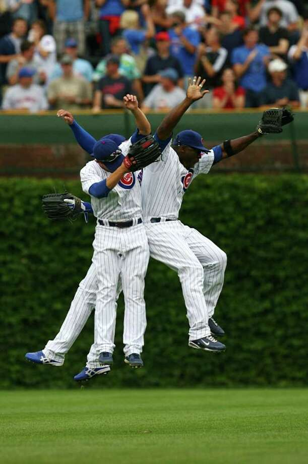 CHICAGO - AUGUST 28: (R-L) Chicago Cubs outfielders Milton Bradley #21, Sam Fuld #27 and Kosuke Fukudome #1 celebrate their 5-2 win over the New York Mets at Wrigley Field on August 28, 2009 in Chicago, Illinois. (Photo by Jonathan Daniel/Getty Images) *** Local Caption *** Kosuke Fukudome;Sam Fuld;Milton Bradley Photo: Jonathan Daniel, Getty Images / 2009 Getty Images