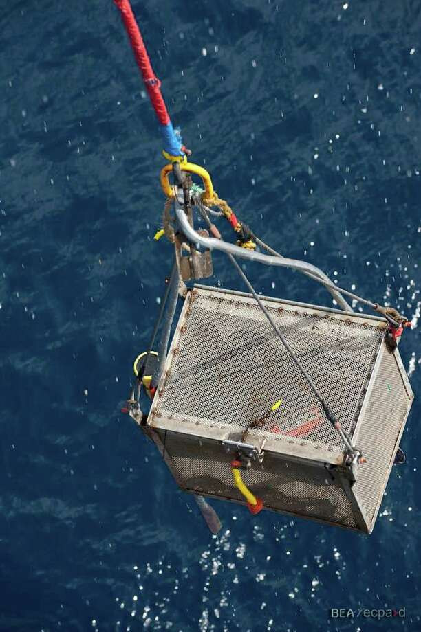 Searchers recover the data module from the flight data recorder from Air France Flight 447. Photo: Bureau D'Enquêtes Et D'Analyses