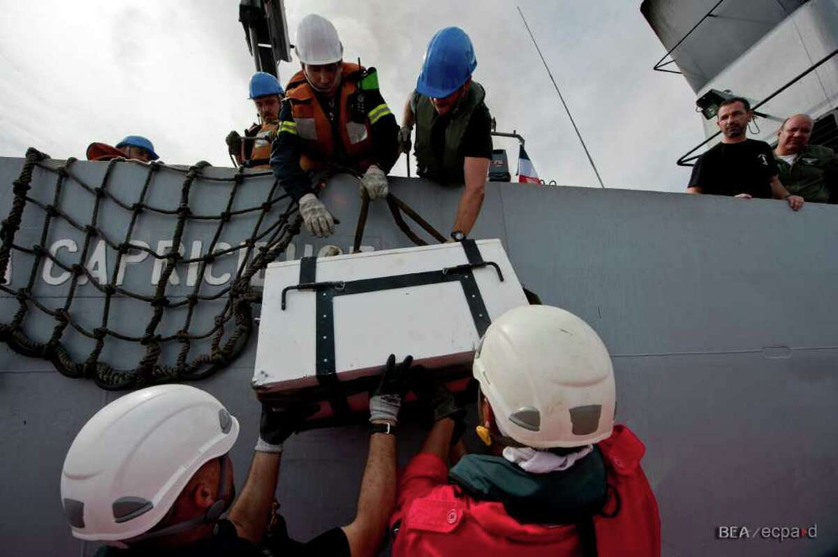 The flight recorders from Air France Flight 447 are transfered to the French Navy patrol boat La Capricieuse on May 7, 2011, in the Atlantic Ocean off the coast of Brazil.