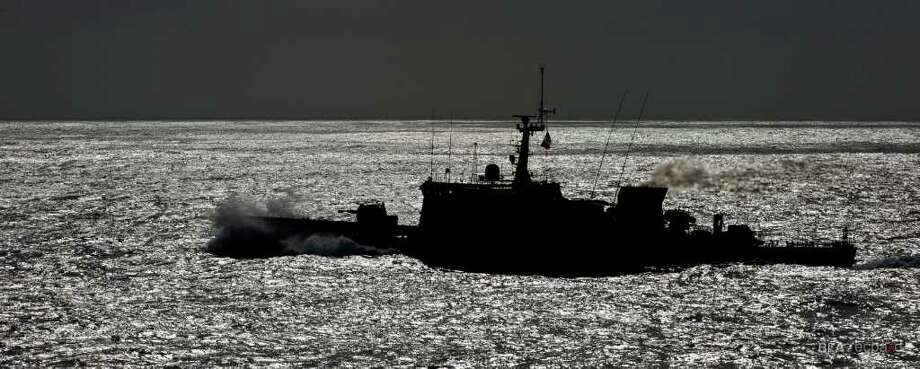 The French Navy patrol boat La Capricieuse leaves the site of the wreckage of Air France Flight 447 on May 7, 2011 after receiving the aircraft's flight recorders. Photo: Bureau D'Enquêtes Et D'Analyses / BEA / ECPAD
