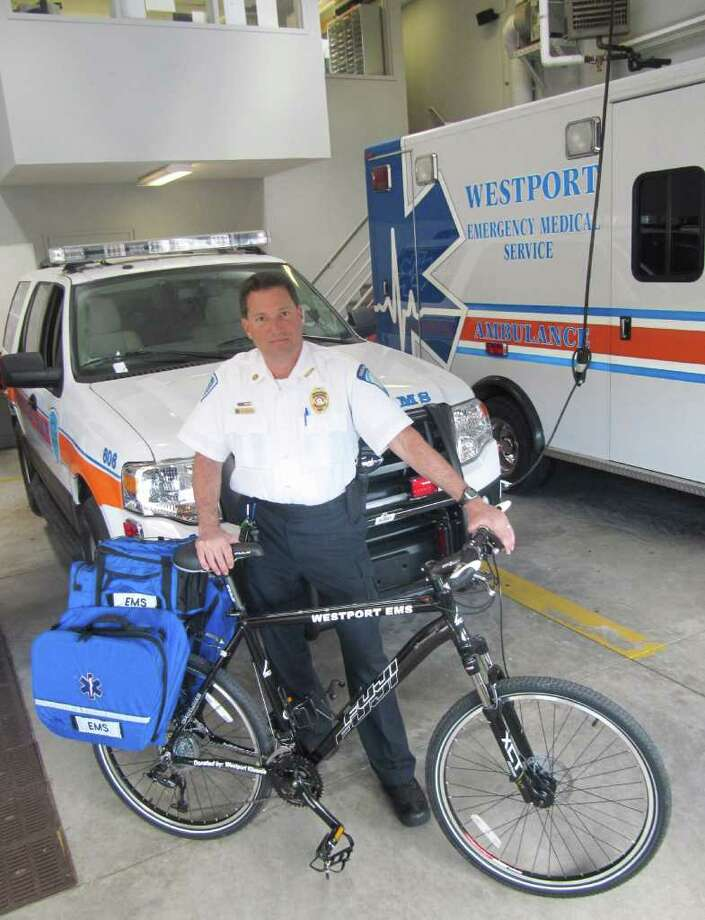 Westport Emergency Medical Service (WEMS) will soon have a bike team. The Westport Kiwanis Club has donated funds to the volunteer arm of WEMS to pay for two bicycles that will be equipped with life-saving equipment. The bikes would be used at large crowd events such as the Memorial Day Parade and the fireworks celebration. Pictured is WEMS Coordinator Marc Hartog with one of the new bikes. Photo: Contributed Photo / Westport News