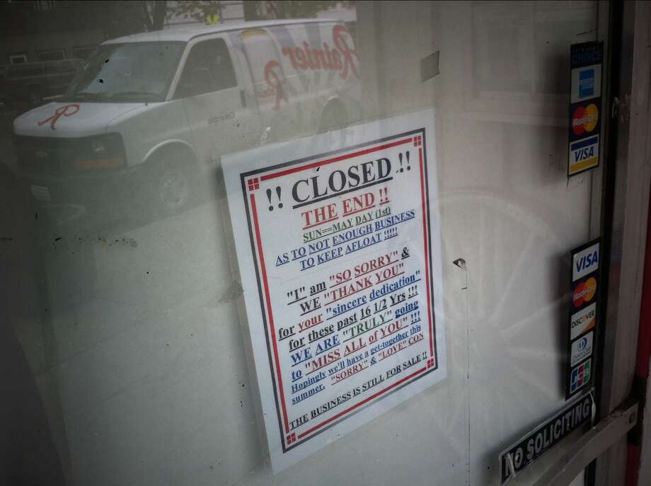 A sign on the door of Lake City's Rimrock Steakhouse informs customers of the closure of the neighborhood bar known as one of the best dive bars in Seattle. The photo was taken May 9, 2011. (Photo by Joshua Trujillo, Seattlepi.com)