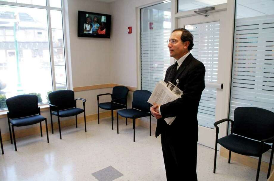 Eric Stein, administrator at Optimus Health Care in the waiting room of a yet-to-be opened new health clinic on the West Side of Stamford, Conn.on Monday May 9, 2011. The clinic represents a partnership between the housing authority and Stamford Hospital/Optimus Health Care. Photo: Dru Nadler / Stamford Advocate Freelance
