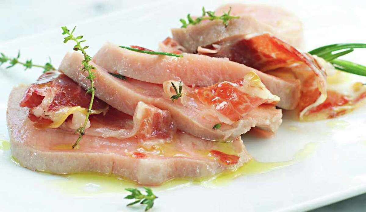 Chef Jose Andres' Iberico pork loin baked in sea salt is served with Spanish ham.