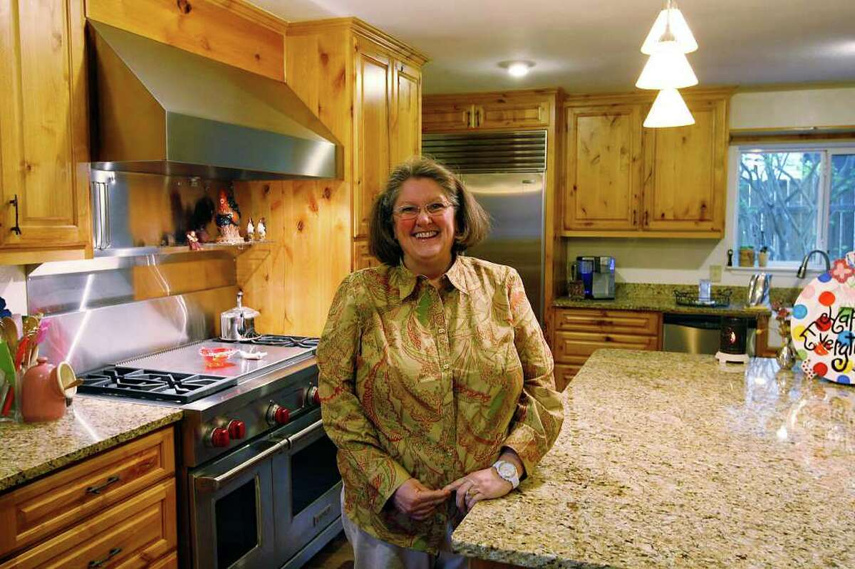 Denise Reynolds chose mottled brown granite and alderwood cabinets when she and her husband expanded their kitchen.