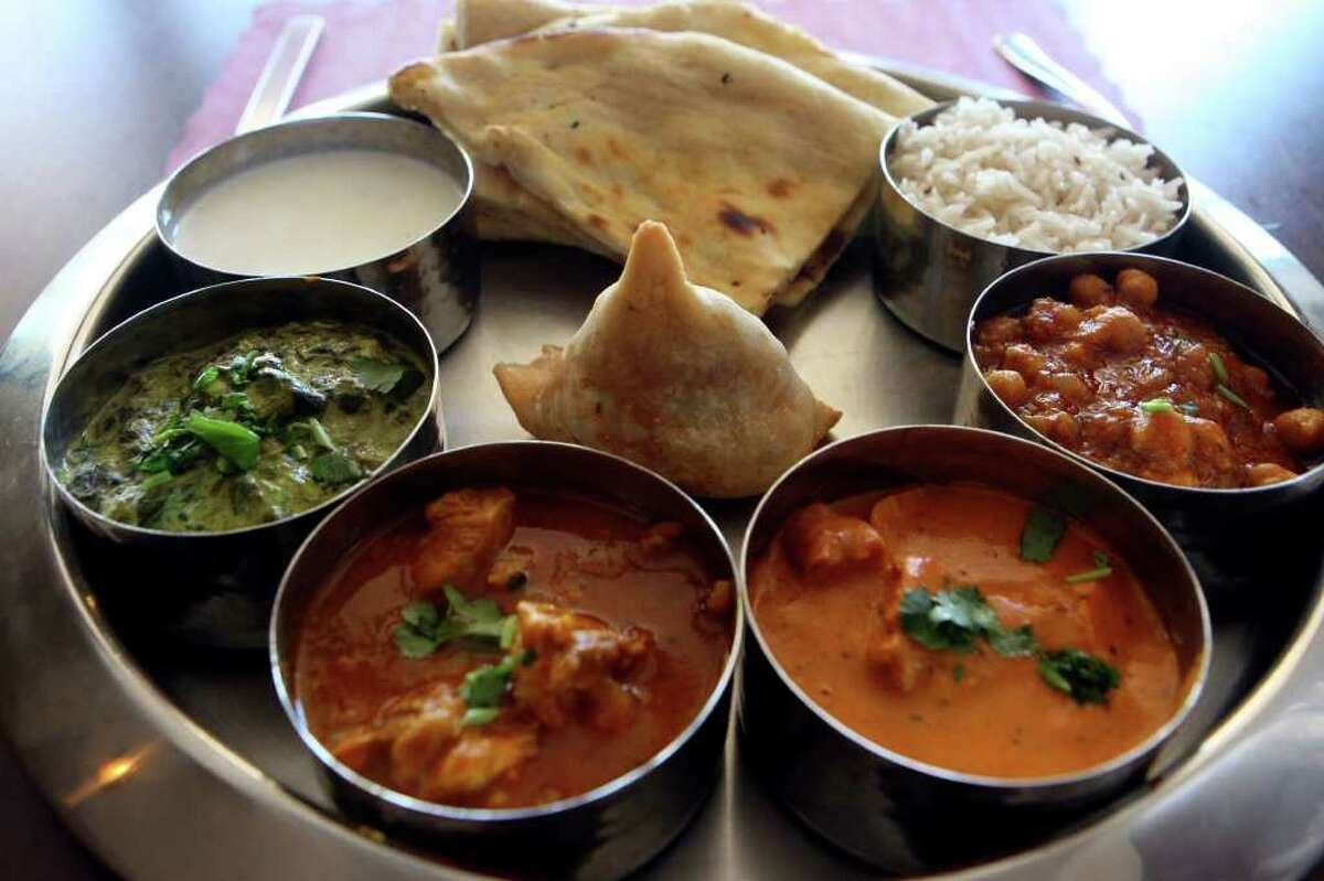 The daily thali special offers a dal dish, and a choice of meats, along with rice and naan. The plate pictured above adds a samosa and raita, a yogurt-mint sauce.