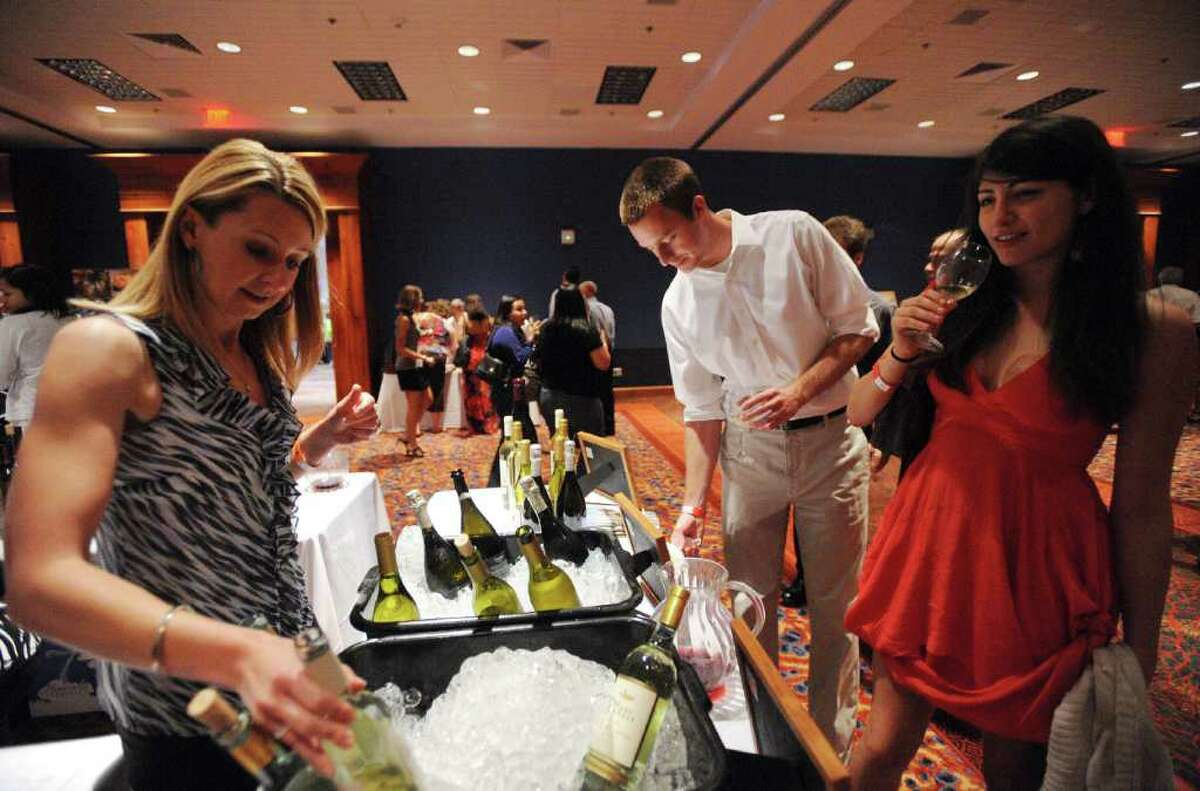 Jessica Feldma (right) and Rusty Fausak sample wines with the help of Krista Short during last year's Culinaria. This year's festival runs Wednesday through May 15 at various spots around San Antonio, including The Pearl, The Shops at La Cantera and Villita Assembly Building.