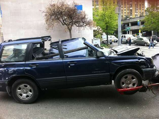 This Subaru Forester went roughly 10 feet down an elevator shaft after a woman drove it through a wall at the Lindeman Pavilion parking garage near Ninth Avenue and Seneca Street. May 9, 2011. (Casey McNerthney/seattlepi.com)