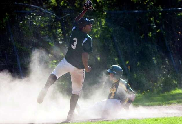 Norwalk's Leon Fleming tags Trinity's Sammy Dominguez out at third as Trinity Catholic hosts Norwalk High School in a baseball game in Stamford, Conn., May 9, 2011. Norwalk won the game 17-1. Photo: Keelin Daly / Stamford Advocate