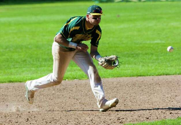 Trinity's Patrick Murphy fields a ball as Trinity Catholic hosts Norwalk High School in a baseball game in Stamford, Conn., May 9, 2011. Norwalk won the game 17-1. Photo: Keelin Daly / Stamford Advocate