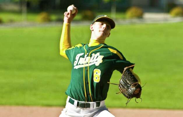 Trinity's Nick Russo throws as Trinity Catholic hosts Norwalk High School in a baseball game in Stamford, Conn., May 9, 2011. Norwalk won the game 17-1. Photo: Keelin Daly / Stamford Advocate