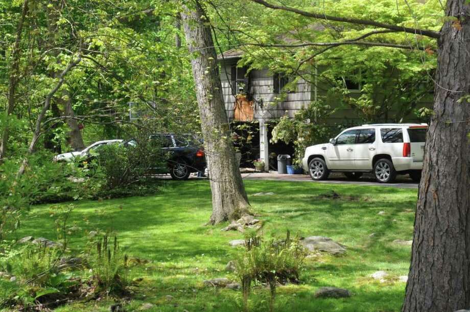 A home at 33 Montgomery Lane was damaged during a fire Sunday. Pictured on Monday, May 9, 2011. Photo: Helen Neafsey / Greenwich Time