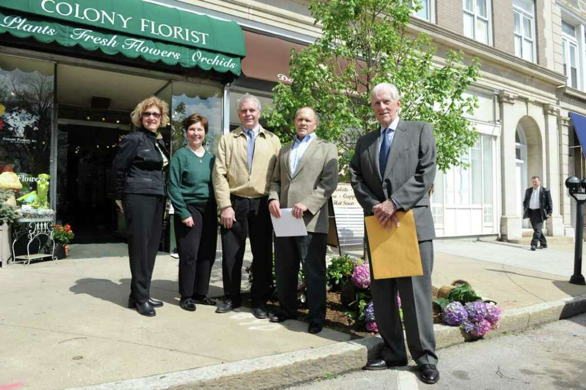 JoAnn Messina, executive director of the Greenwich Tree Conservancy, presented a certificate of appreciation on Arbor Day, April 29, to longtime Greenwich residents Philip Drake and B. Cort Delany for the donation of a tree planted on Greenwich Avenue. The tree was planted near Cummings & Lockwood's first office in Greenwich that opened 50 years ago at 12 Havemeyer Place. Drake was the partner who opened the office in 1960. Delany joined the firm in 1993 and is currently partner-in-charge of the Greenwich office. State Rep. Livvy Floren, co-chair of the conservancy's advisory board., and Town Tree Warden Bruce Spaman were also in attendance.