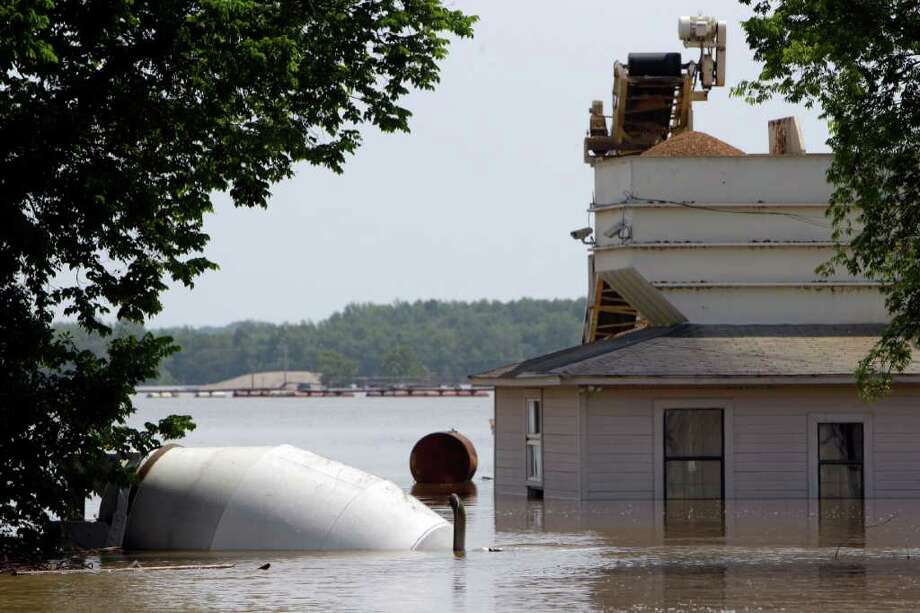 A concrete truck is seen submerged in floodwater Monday, May 9, 2011, in Memphis, Tenn. Memphis residents are waiting for the Mississippi River to reach its peak expected as early as Monday night as the river rises near its highest level ever in Memphis, flooding pockets of low-lying neighborhoods. (AP Photo/Jeff Roberson) Photo: Jeff Roberson