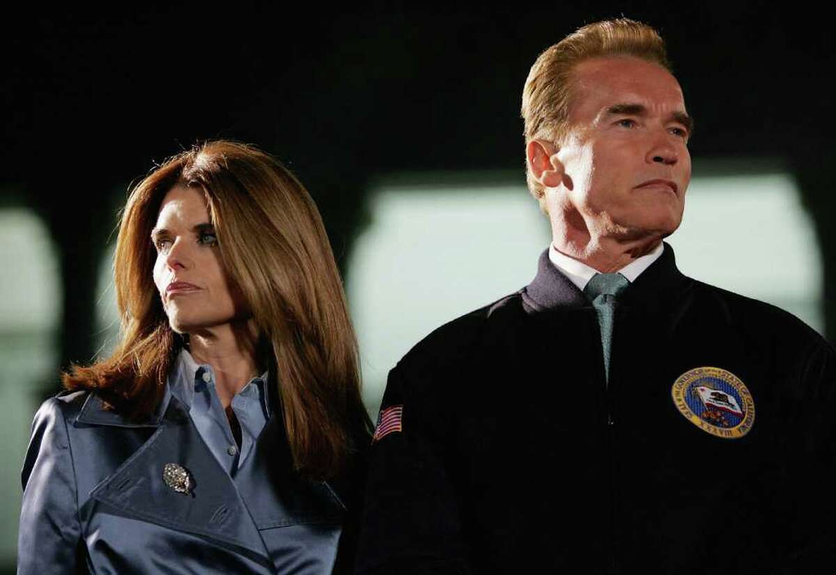 California Governor Arnold Schwarzenegger (R) and his wife Maria Shriver look on during the 73rd annual Christmas Tree Lighting Ceremony December 2, 2004 at the state capitol in Sacramento, California. This year's tree is a 56-foot White Douglas Fir with approximately 4000 lights and 1500 ornaments, 725 of which were made by persons with disabilities from across California. (Photo by Justin Sullivan/Getty Images)