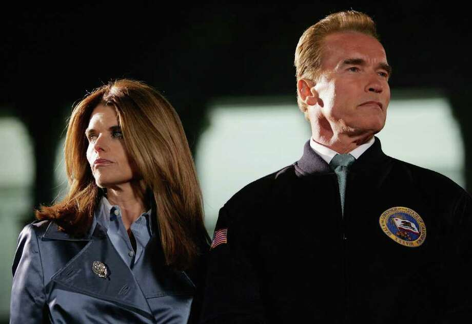 California Governor Arnold Schwarzenegger (R) and his wife Maria Shriver look on during the 73rd annual Christmas Tree Lighting Ceremony December 2, 2004 at the state capitol in Sacramento, California. This year's tree is a 56-foot White Douglas Fir with approximately 4000 lights and 1500 ornaments, 725 of which were made by persons with disabilities from across California. (Photo by Justin Sullivan/Getty Images) Photo: Justin Sullivan, Getty Images / Getty Images