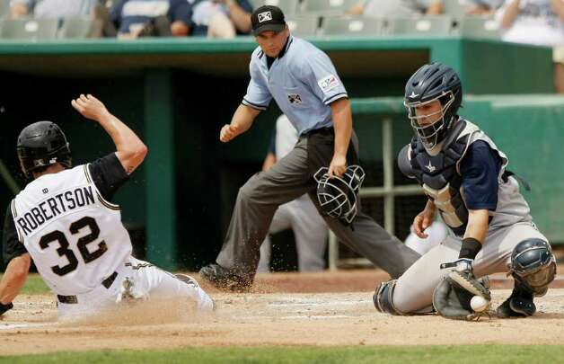 Umpire Matt Benham (center) watches as the Missions' Daniel Robertson (left) slides safe into home as Corpus Christi Hooks' Federico Hernandez catches the ball during a game on Monday, May 9, 2011, in San Antonio. San Antonio won 5-2. Photo: Darren Abate/Special To The Express-News