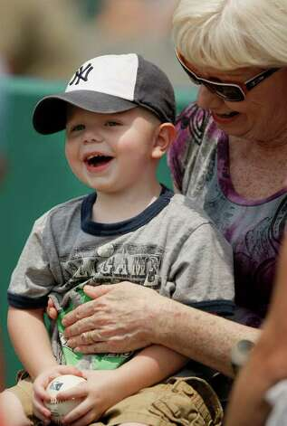 Doreen Wells (right) and grandson Timothy Mizell, 2, watch a game between the San Antonio Missions and the Corpus Christi Hooks on Monday, May 9, 2011, in San Antonio. San Antonio won 5-2. Photo: Darren Abate/Special To The Express-News