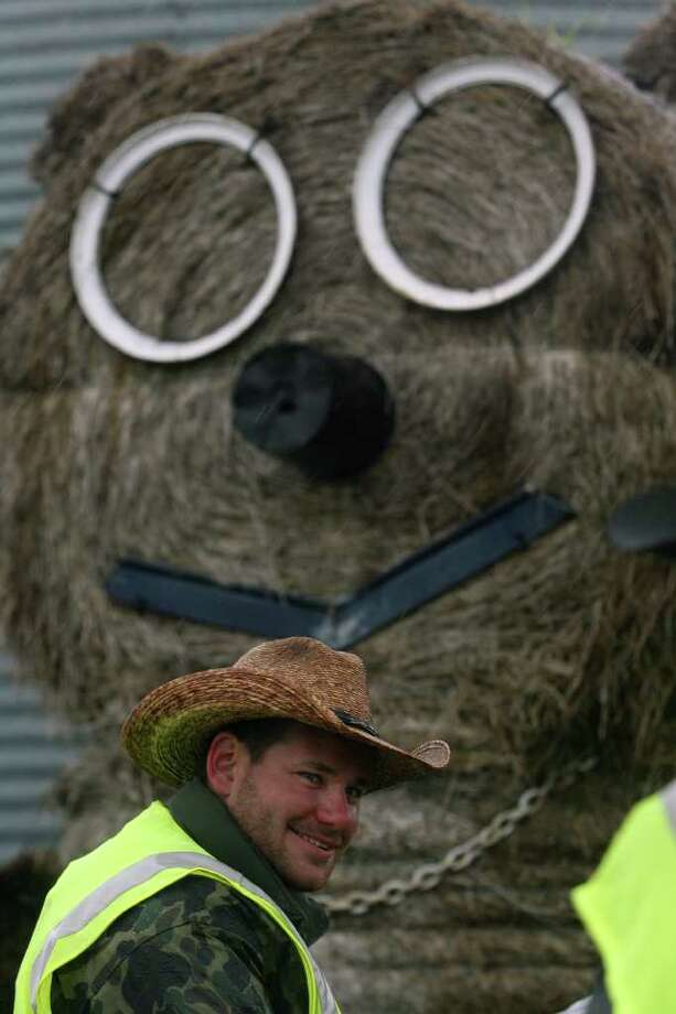 A round bale of hay with a face put on it looms over an area where the Mesquite Traildrivers stopped for a morning break while en route to San Antonio. JOHN DAVENPORT/jdavenport@express-news.net Photo: JOHN DAVENPORT, SAN ANTONIO EXPRESS-NEWS / jdavenport@express-news.net