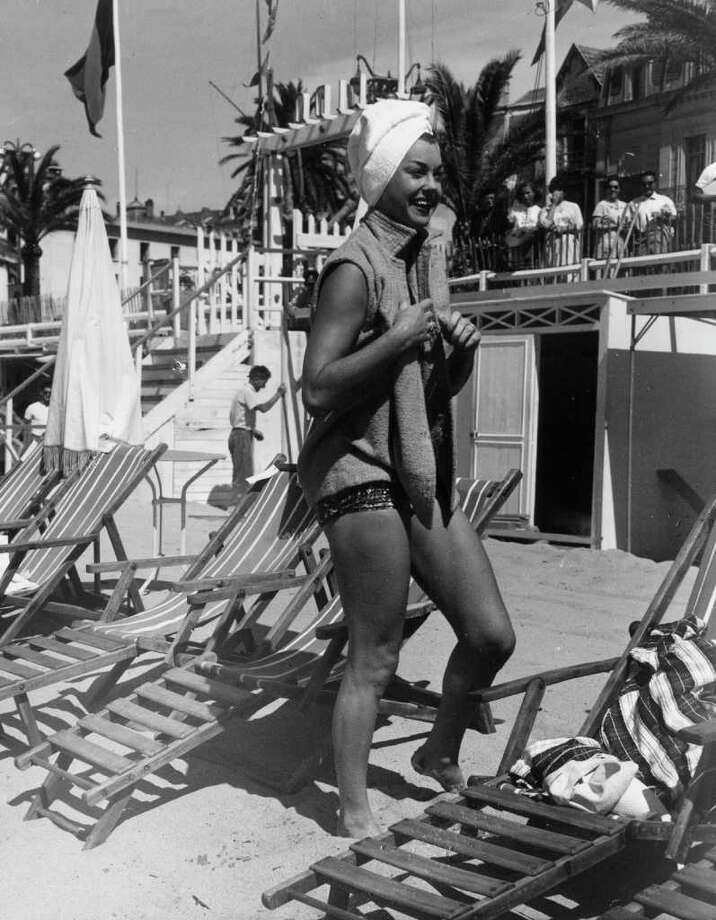 American actress and former swimming champion Esther Williams after a swim on the Place Martinez beach at Cannes. Photo: George W. Hales, Getty Images / Hulton Archive